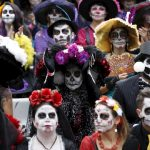 """People with their faces painted to look like the popular Mexican figure called """"Catrina"""" take part in the annual Catrina Fest in Mexico City"""