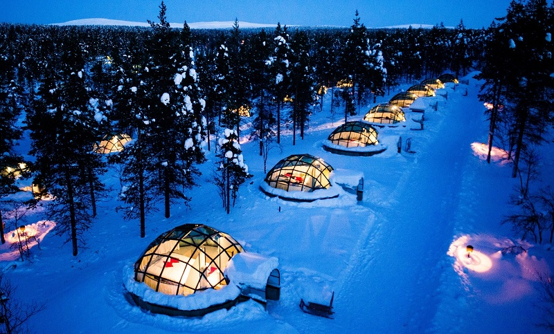 skyline view of igloo like homes in Finland during winter