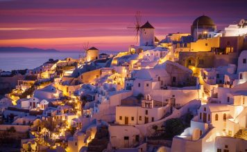 Dramatic Sunset in Mediterranean Town of Oia, Santorini, Greece,